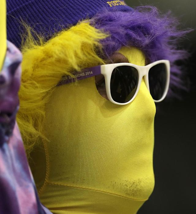 An Albany band member cheers during the first half of an NCAA America East college championship basketball game between Albany and Stony Brook on Monday, March 10, 2014, in Albany, N.Y. (AP Photo/Mike Groll)