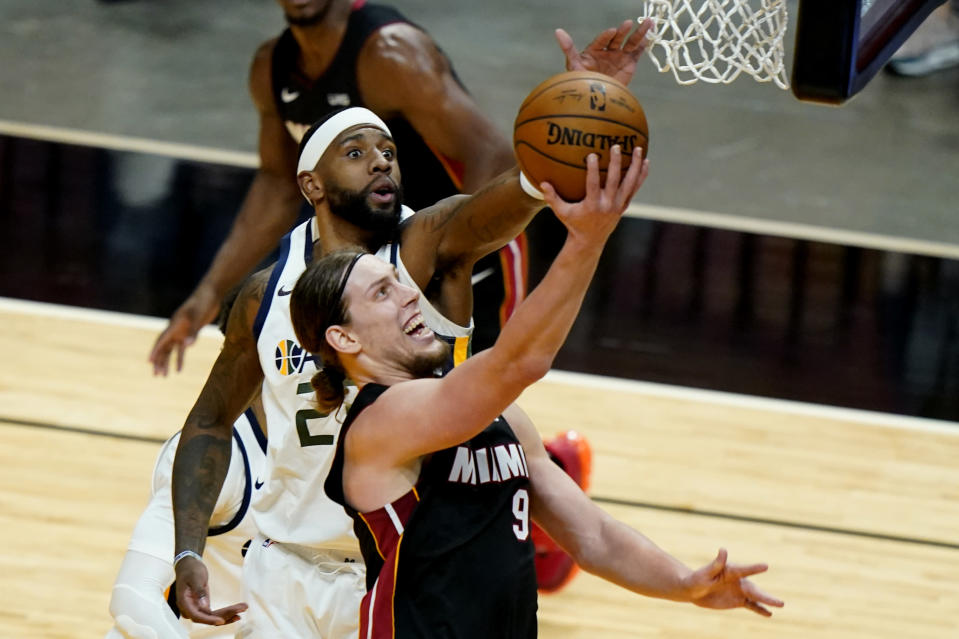 Miami Heat forward Kelly Olynyk (9) goes to the basket as Utah Jazz forward Royce O'Neale defends during the first half of an NBA basketball game, Friday, Feb. 26, 2021, in Miami. (AP Photo/Lynne Sladky)