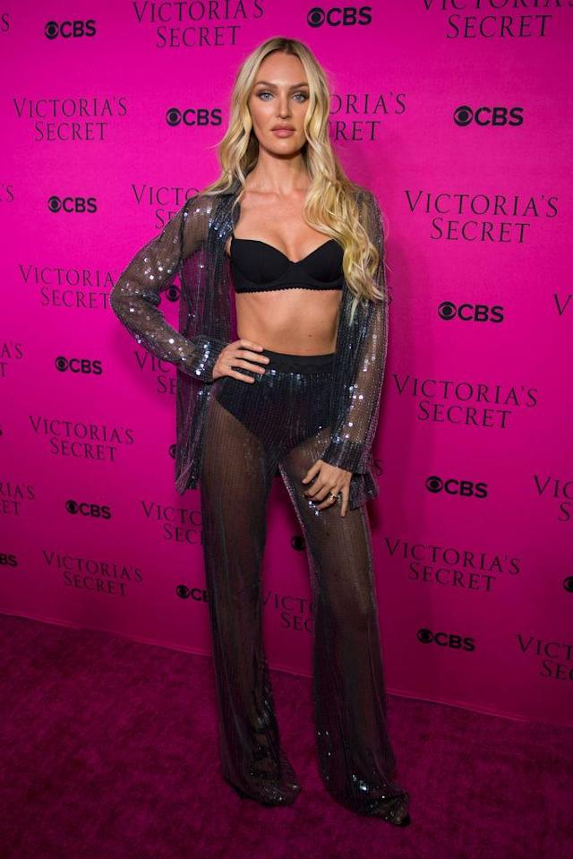 "<p>Supermodel Swanepoel arrived on the 2017 <a href=""https://www.yahoo.com/lifestyle/tagged/victorias-secret-fashion-show"" data-ylk=""slk:Victoria's Secret Fashion Show"" class=""link rapid-noclick-resp"">Victoria's Secret Fashion Show</a> viewing party pink carpet in a black bra with a sheer metallic blue cover-up. (Photo: Getty Images) </p>"