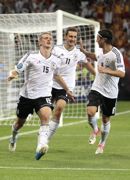 Germany's Lars Bender, left, celebrates after scoring his side's second goal during the Euro 2012 soccer championship Group B match between Denmark and Germany in Lviv, Ukraine, Sunday, June 17, 2012. (AP Photo/Ivan Sekretarev)