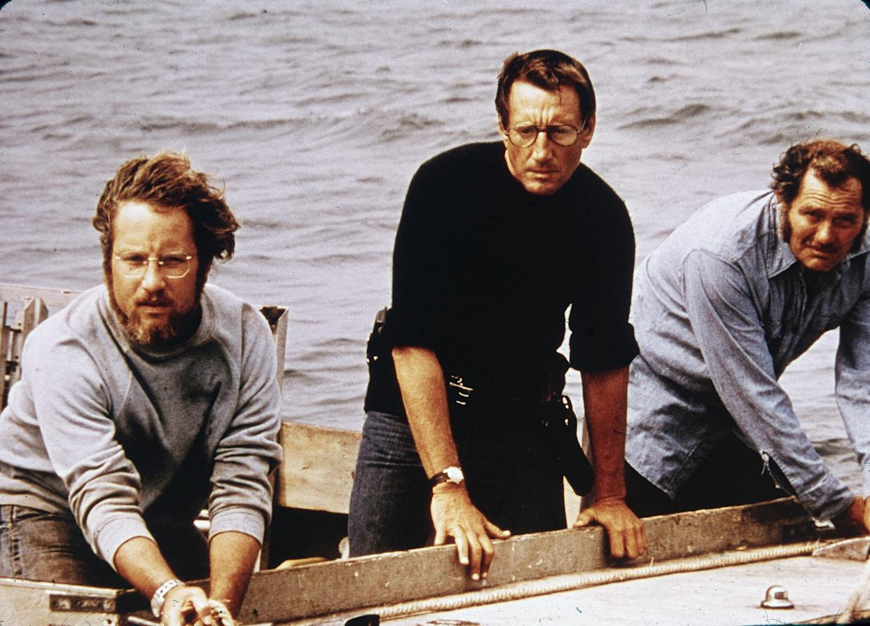 L-R: American actors Richard Dreyfuss, Roy Scheider and Robert Shaw on board a boat in a still from the film, 'Jaws,' directed by Steven Spielberg, 1975. (Photo by Universal Studios/Courtesy of Getty Images)