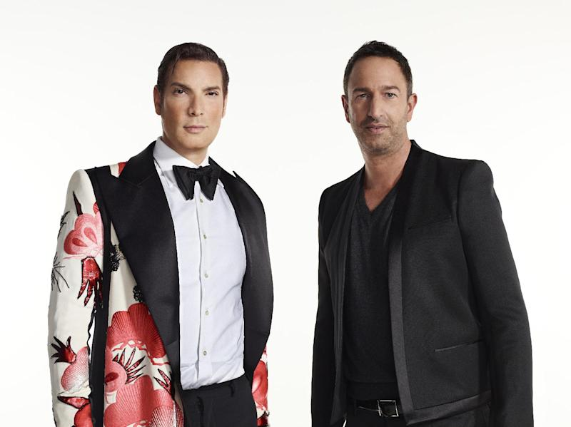 """This undated photo provided by Bravo shows Cameron Silver, left, and Christos Garkinos, owners of Los Angeles vintage store Decades, and hosts of the new reality TV show """"Dukes of Melrose."""" Silver and Garkinos hold many style secrets of fashion's royalty, and the duo dish some of them on the new Bravo series. (AP Photo/Bravo, Mike Rosenthal)"""