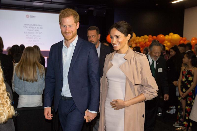 "Britain's Prince Harry and his wife Meghan, the Duchess of Sussex arrive for a visit to Pillars, a charity operating across New Zealand that supports children who have a parent in prison by providing special mentoring schemes, in Manukau City in Auckland on October 30, 2018. - Meghan Markle displayed an unexpected talent for ""welly wanging"" in Auckland on October 30, gaining bragging rights over husband Prince Harry after they competed in the oddball New Zealand sport."