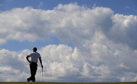 Tiger Woods of the U.S. waits to putt during the first round of the British Open golf championship at Muirfield in Scotland