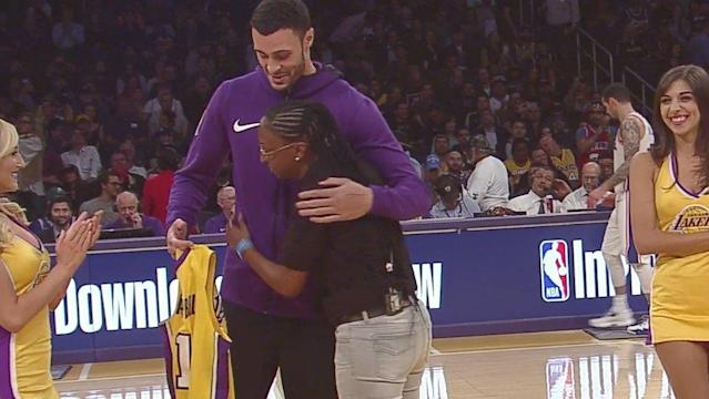 Lakers forward Larry Nance Jr. embraces U.S. Army Specialist Bianca Campbell, his old pen pal. (Screencap via NBA)