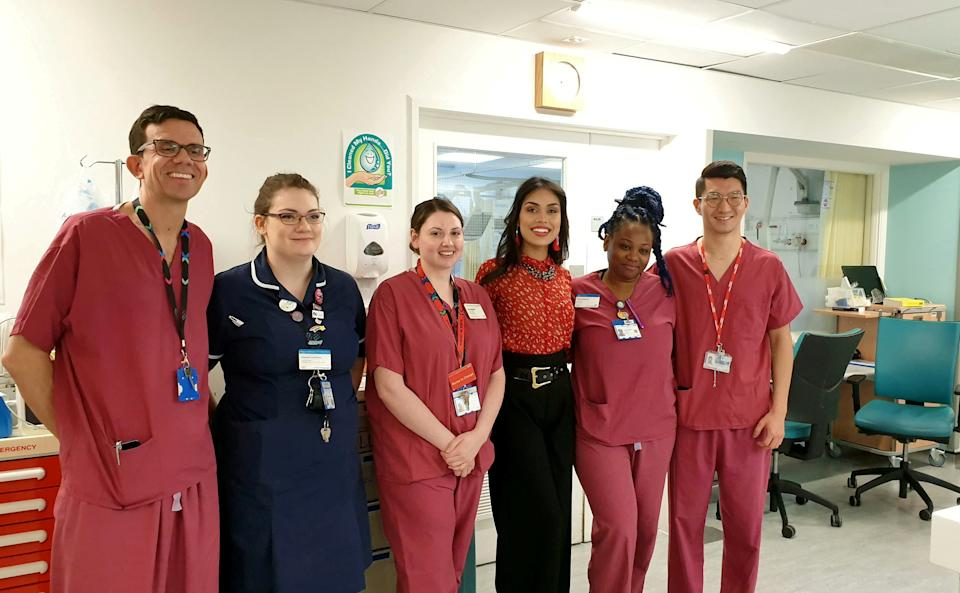 Dr Bhasha Mukherjee pictured with her colleagues in the hospital. (SWNS)