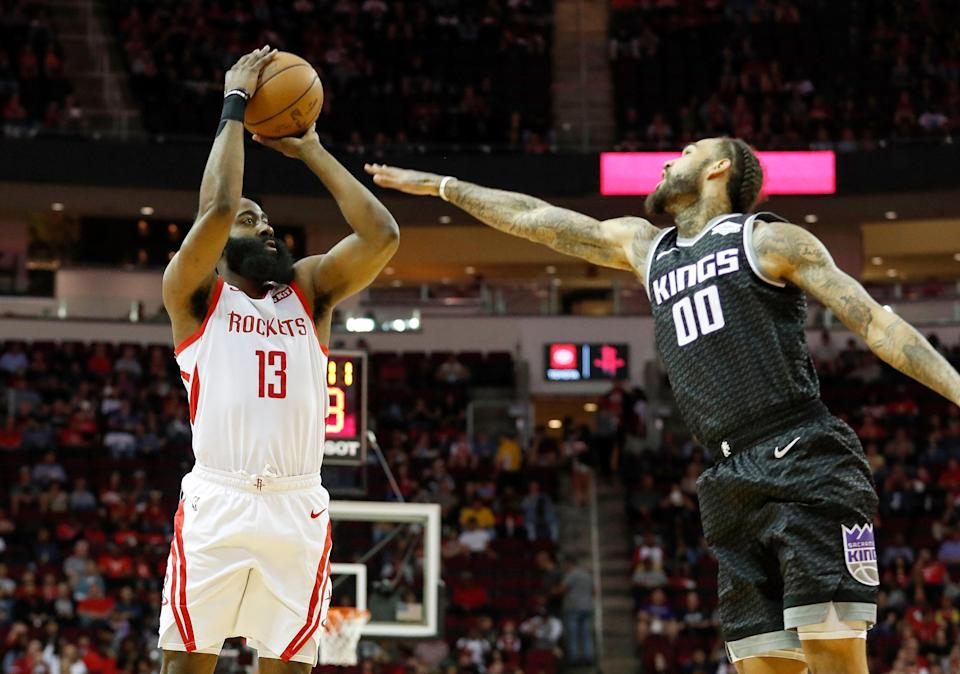 HOUSTON, TX - MARCH 30:  James Harden #13 of the Houston Rockets takes a three point shot defended by Willie Cauley-Stein #00 of the Sacramento Kings in the first half at Toyota Center on March 30, 2019 in Houston, Texas.  NOTE TO USER: User expressly acknowledges and agrees that, by downloading and or using this photograph, User is consenting to the terms and conditions of the Getty Images License Agreement.  (Photo by Tim Warner/Getty Images)