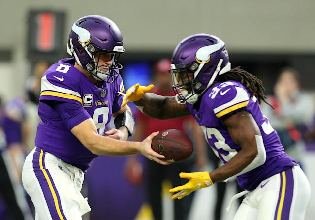 Kirk Cousins projects to be handing the ball off more to Dalvin Cook this season. (Getty Images)