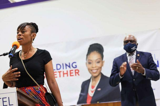 PHOTO: Cuyahoga Councilwoman and Congressional Candidate Shontel Brown speaks as Rep. James Clyburn claps during Get Out the Vote campaign event at Mt Zion Fellowship, July 31, 2021, in Cleveland. (Michael M. Santiago/Getty Images)