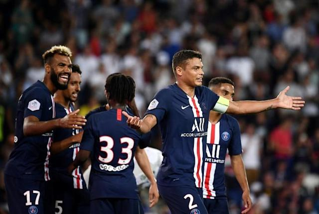 Paris Saint-Germain players Eric-Maxim Choupo-Moting (L) and Thiago Silva (R) had their homes targeted in a series of burglaries late last year (AFP Photo/FRANCK FIFE)