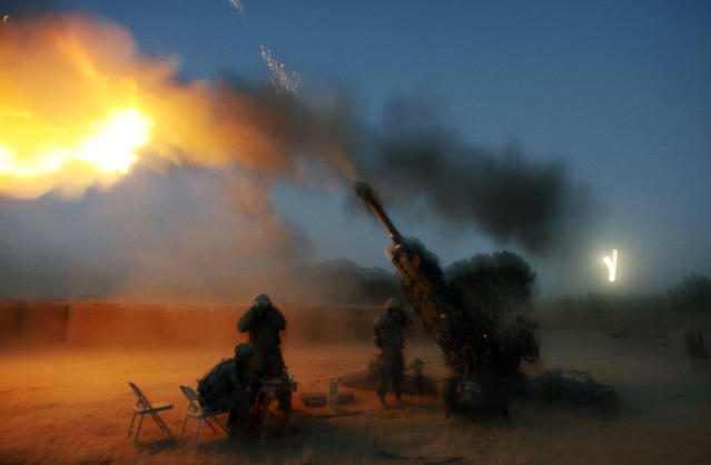 <p>Soldiers from the U.S. Army's Alpha Battery, 425 Field Artillery, 3rd brigade of 10th Mountain Division based in Fort Drum, New York, fire their 155 mm Howitzer in Cop Cherokee base in Kherwar district in Logar province Oct. 4, 2009. (Photo: Nikola Solic/Reuters) </p>