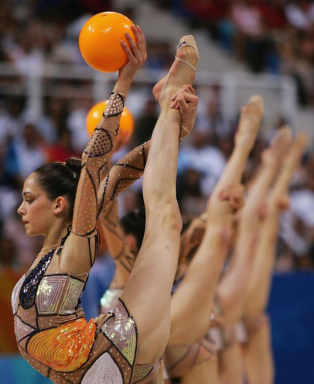 ATHENS - AUGUST 28: The Spanish team compete in the hoops and balls round of the rhythmic gymnastics group finals on August 28, 2004 during the Athens 2004 Summer Olympic Games at the Galatsi Olympic Hall in Athens, Greece. (Photo by Scott Barbour/Getty Images)