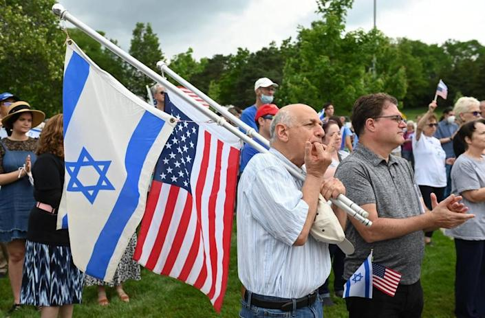 """Efi Kamara, left, and Gil Nevat, listened as Jewish leaders spoke in support of Israel and peace in the Middle East during a """"Vigil for Israel,"""" a community gathering Sunday, May 23, at the Jewish Community Center campus in Overland Park."""