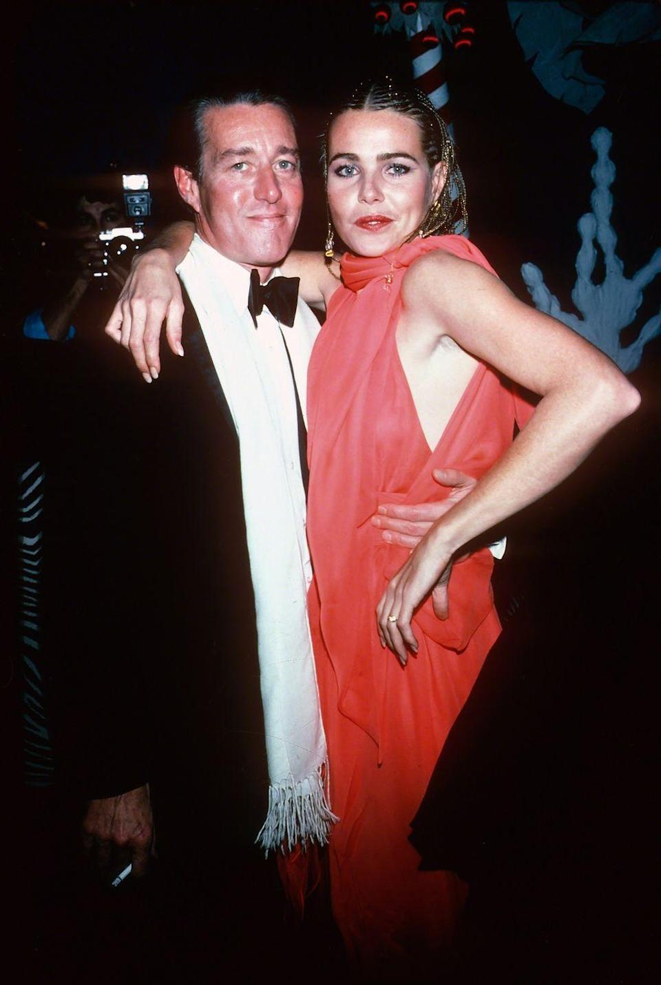 <p>Halston socialized with some of Hollywood's biggest stars. He's pictured here with actress and model Margaux Hemingway.</p>