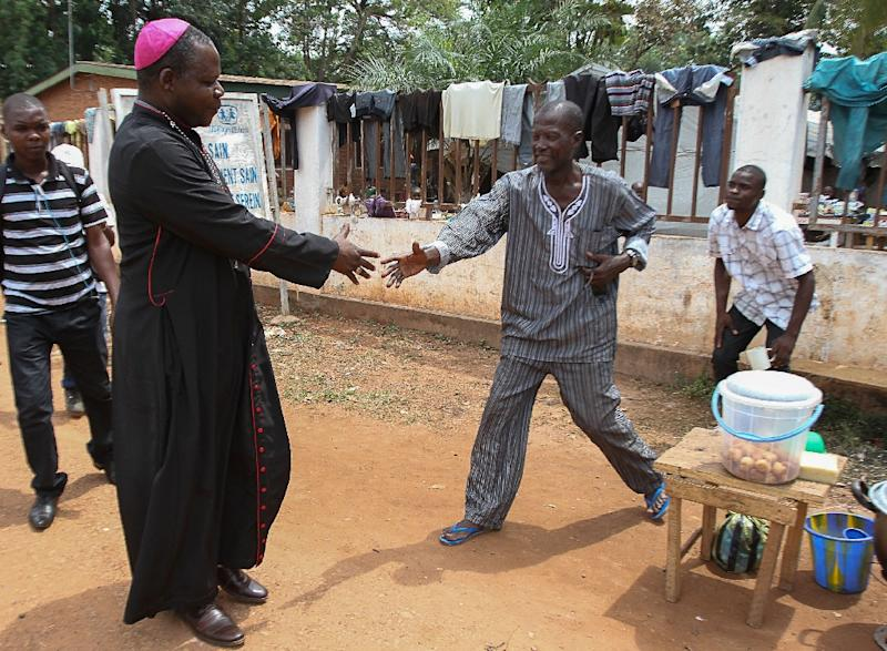 Bangui's Archbishop Mgr. Dieudonne Nzapalainga visits the Pope Jean XIII camp for internally displaced people, on October 6, 2015 (AFP Photo/Edouard Dropsy)