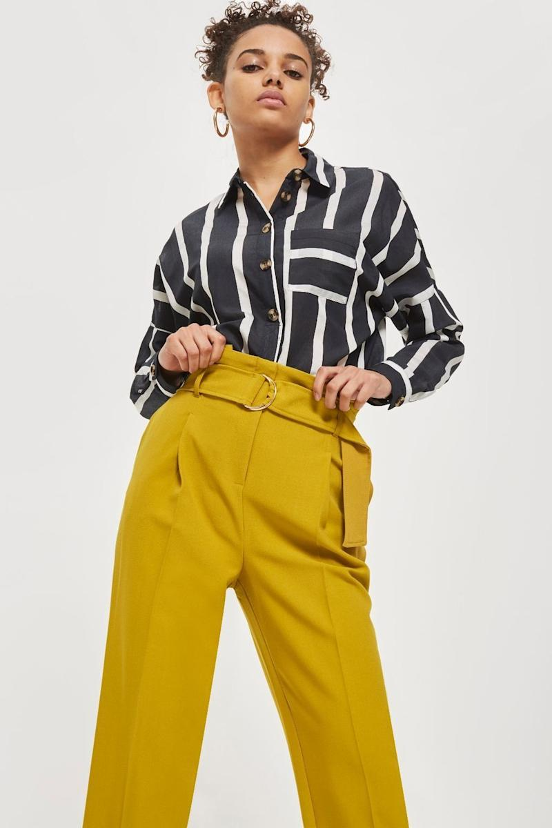 "Get them at <a href=""http://us.topshop.com/en/tsus/product/belted-tapered-trousers-7480776?bi=20&ps=20"" target=""_blank"">Topshop</a>, $68."