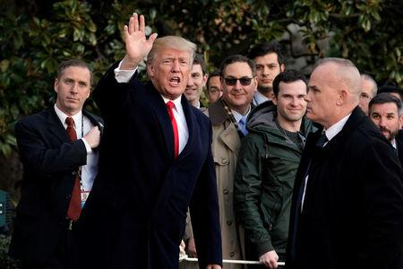 U.S. President Donald Trump waves to reporters on South Lawn of the White House upon his return in Washington from Pittsburgh, U.S., January 18, 2018. REUTERS/Yuri Gripas