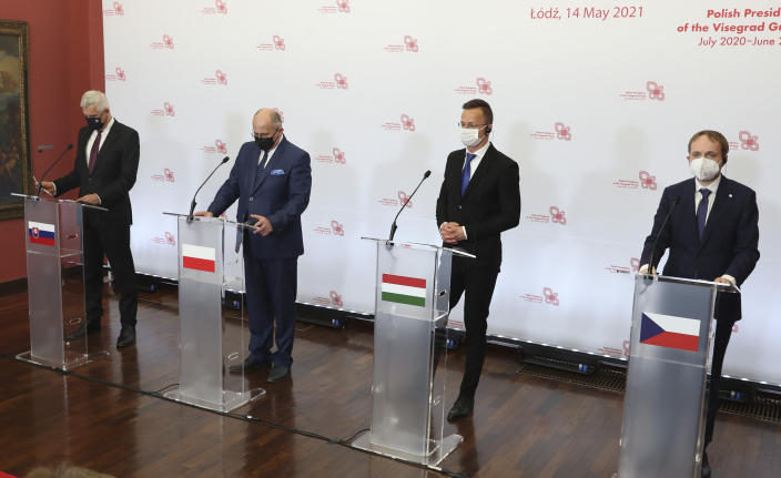 Slovak Foreign Minister Ivan Korcok, left, Polish Foreign Minister Zbigniew Rau, Hungarian Foreign Minister Peter Szijjarto and Czech Republic Foreign Minister Tomas Petricek,right, during a press conference after the foreign ministers of the Visegrad Group ,V4, in Lodz, Poland, Friday, May 14, 2021.( AP Photo/Czarek Sokolowski)