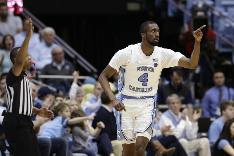 North Carolina guard Brandon Robinson (4) reacts after a 3-point basket during the second half of an NCAA college basketball game against Miami in Chapel Hill, N.C., Saturday, Jan. 25, 2020. (AP Photo/Gerry Broome)