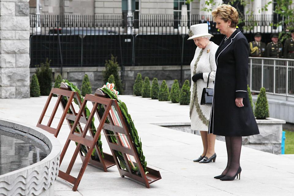 DUBLIN, IRELAND - MAY 17: Queen Elizabeth II and President Mary McAleese lay a wreaths at the Garden of Remembrance on May 17, 2011 in Dublin, Ireland. The Duke and Queen's visit is the first by a monarch since 1911. An unprecedented security operation is taking place with much of the centre of Dublin turning into a car free zone. Republican dissident groups have made it clear they are intent on disrupting proceedings.  (Photo by Irish Government - Pool/Getty Images)