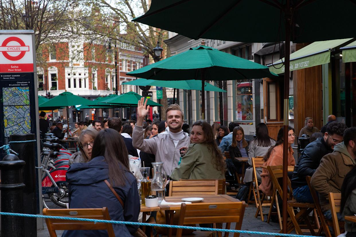 Londoners enjoy outdoor restaurants and pubs in landmark Soho district of central London as Coronavirus restrictions start to ease and the economy start to pick up in London, England on April 27, 2021. The Prime Minister Boris Johnson has set a road map on easing the restrictions. English bar and restaurants can host people in their outdoors facilities.