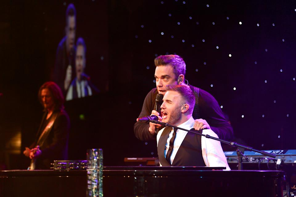 FILE - Robbie Williams, left, and Gary Barlow perform at the 2012 Music Industry Trusts Award ceremony at the Grosvenor House Hotel on Monday, Nov. 5, 2012, in London. (Photo by John Marshall JM Enternational/Invision/AP)
