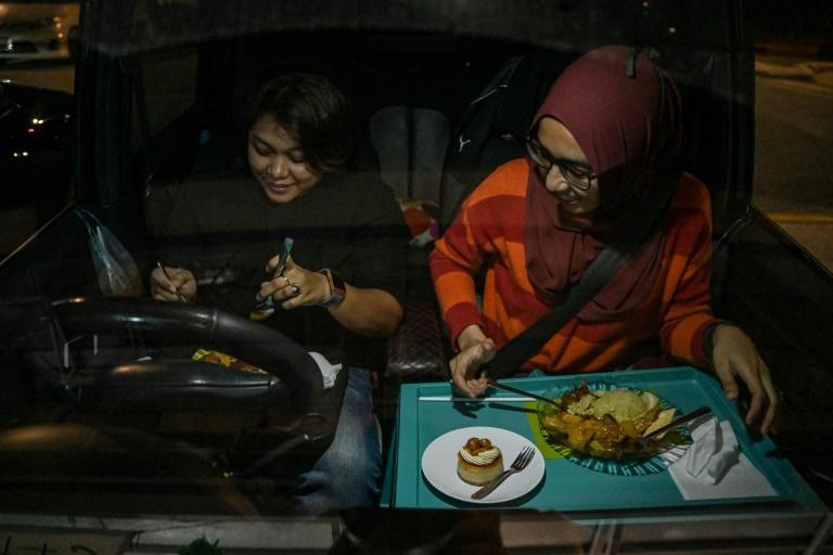 Lockdown-weary Malaysians have jumped at the chance for an unusual eating-out experience allowing them to enjoy restaurant food despite coronavirus curbs