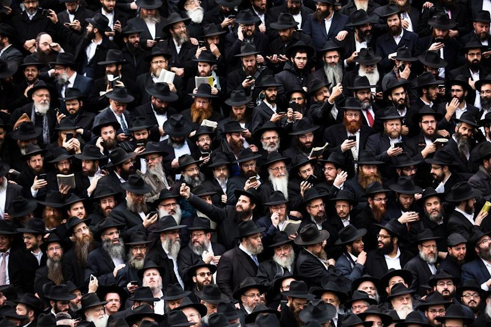 <p>Hasidic Rabbis prepare to pose for a group photo as part of the annual International Conference of Chabad-Lubavitch Emissaries, in front of Chabad Lubavitch World Headquarters. This happens in the Crown Heights neighborhood of the Brooklyn borough of New York City. They are among 4600 rabbis from around the world who are in New York for international conference aimed at reviving jewish awareness around the world. (Amir Levy/Getty Images) </p>