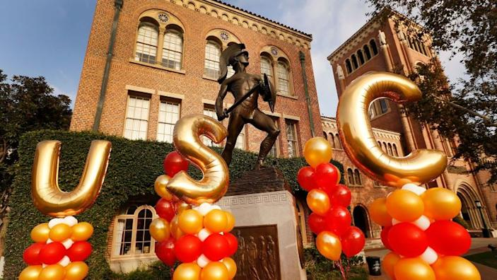 "Balloons near Tommy Trojan at USC's annual parents weekend in 2017. The university announced Tuesday that fall semester classes will be held on campus. <span class=""copyright"">(Los Angeles Times)</span>"