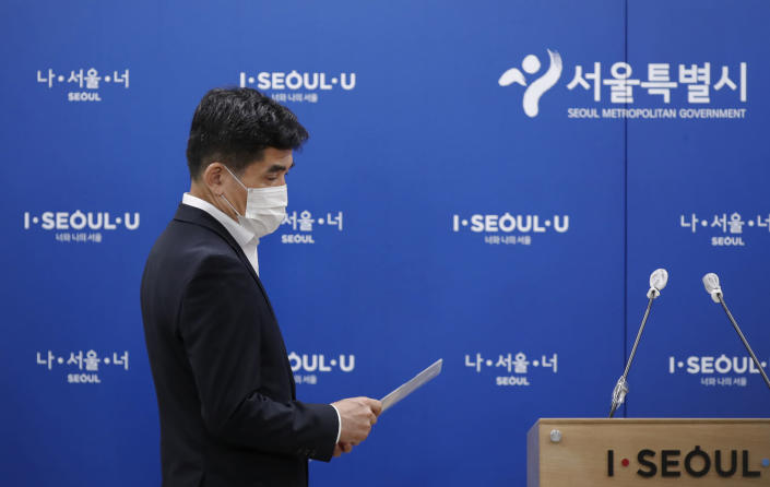 Seoul Metropolitan Government spokesperson Hwang In-sik arrives for a press conference at Seoul City Hall in Seoul, South Korea, Wednesday, July 15, 2020. The city government of the South Korean capital, Seoul, said Wednesday it will launch an investigation into allegations of sexual misconduct surrounding late Mayor Park Won-soon, who was found dead after one of his secretaries filed a complaint claiming yearslong abuse. (AP Photo/Lee Jin-man)