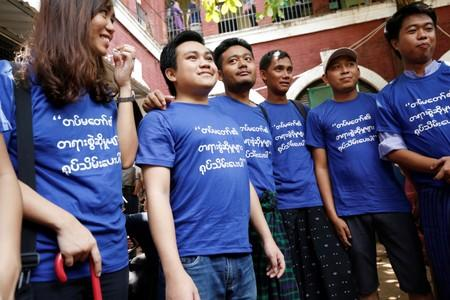 Youth activists wear blue shirts, the color of the countryÕs prison uniform, to call for freedom of expression, as they talk to the media at Insein court in Yangon