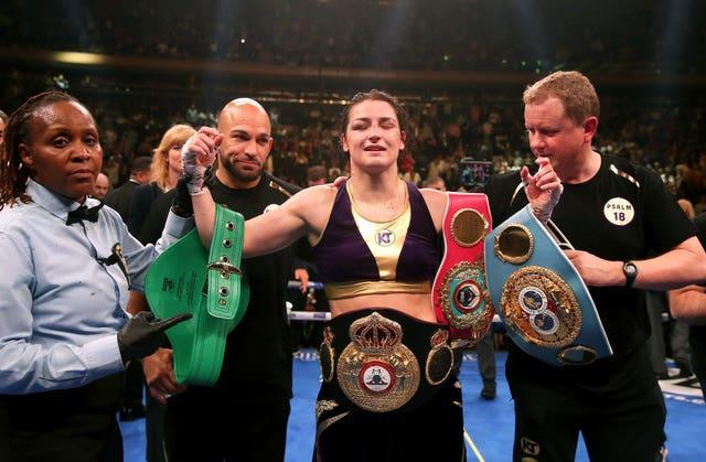 Katie Taylor, centre, is the undisputed lightweight champion (Nick Potts/PA)