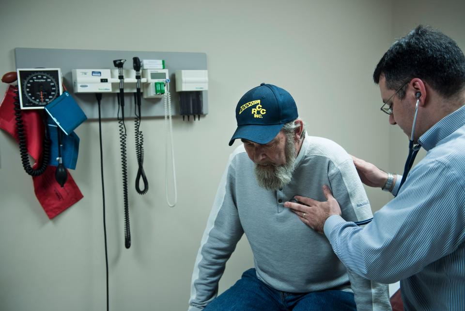 Don Humbertson, a 64 year old lung cancer survivor, is examined by Dr. Wade Harvey in Blacksville, West Virginia. (Photo: BRENDAN SMIALOWSKI/AFP via Getty Images)