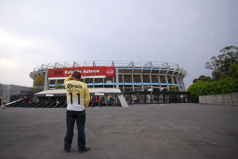 MEXICO CITY, MEXICO - MARCH 15: A fan of America looks the closed stadium prior to the 10th round match between America and Cruz Azul as part of the Torneo Clausura 2020 Liga MX at Azteca Stadium on March 15, 2020 in Mexico City, Mexico. The match is played behind closed doors to prevent the spread of the novel Coronavirus (COVID-19). (Photo by Mauricio Salas/Jam Media/Getty Images)