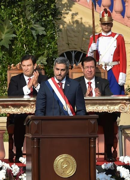 Paraguay's new President Mario Abdo Benitez (C) delivers a speech after being sworn-in, in Asuncion, on August 15, 2018
