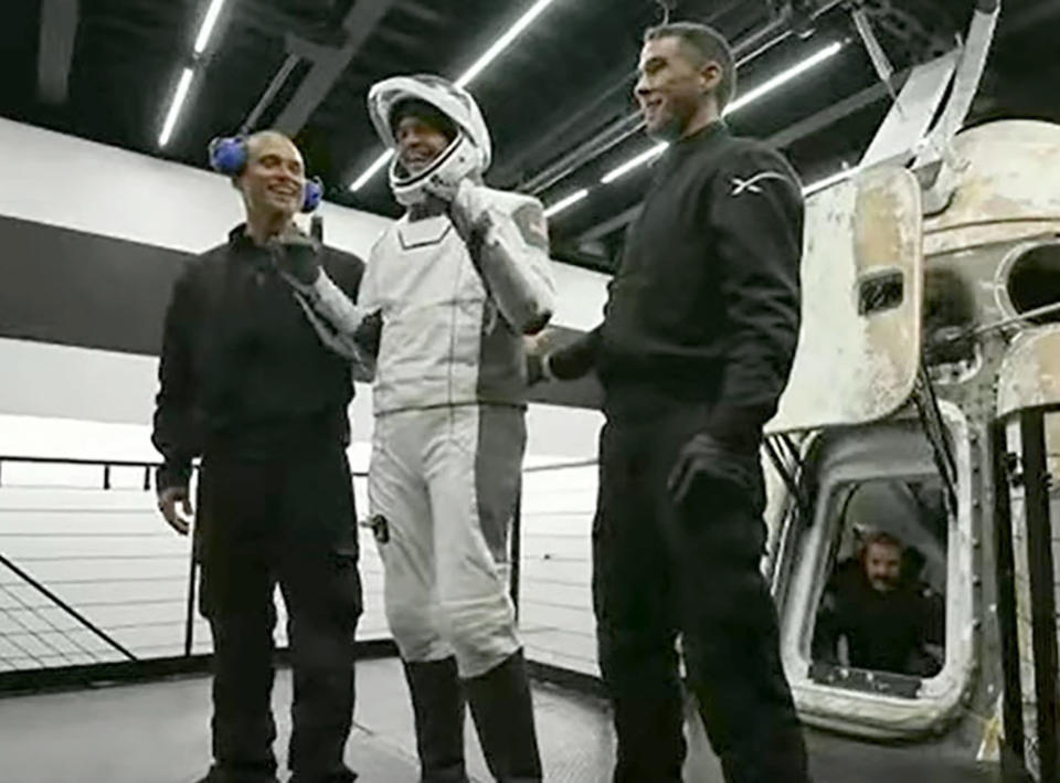 In this image taken from video, Jared Isaacman, one of four passengers aboard the SpaceX capsule, reacts after emerging from the capsule Saturday, Sept. 18, 2021, after it was recovered following its splashdown in the Atlantic off the Florida coast. The all-amateur crew was the first to circle the world without a professional astronaut. (Inspiration4 via AP)