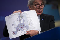 European Commissioner for Internal Market Thierry Breton shows a map of Europe as he talks to journalists during an online news conference at the EU headquarters in Brussels, Thursday, Sept. 3, 2020. Worried by an increasing dependency on the raw materials used to make smart phones, televisions and energy-saving lights, the European Union on Thursday launched a new strategy to secure access to rare earth minerals and reduce reliance on suppliers like Chile, China and South Africa. (AP Photo/Francisco Seco, Pool)
