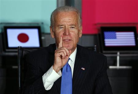 U.S. Vice President Joe Biden gestures as he speaks to Japanese business leaders during their meeting at the headquarters of internet commerce and mobile games provider DeNA Co. in Tokyo