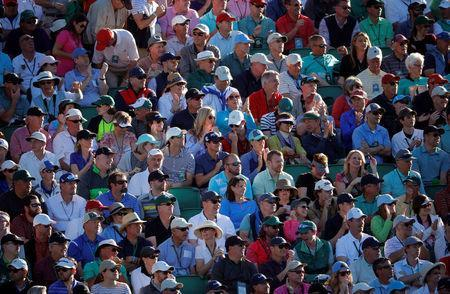 FILE PHOTO : The crowd watches play on the 15th hole, with none of the patrons using a cellular phone because they are not allowed, in third round play during the 2017 Masters golf tournament at Augusta National Golf Club in Augusta, Georgia, U.S., April 8, 2017. REUTERS/Lucy Nicholson/File Photo