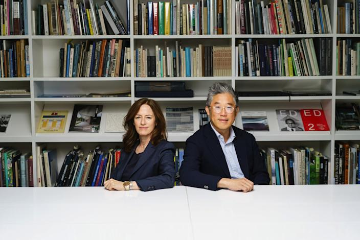 """Sharon Johnston and Mark Lee in their studio's library in 2019. <span class=""""copyright"""">(Marcus Yam / Los Angeles Times)</span>"""