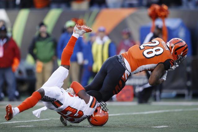 <p>Joe Mixon #28 of the Cincinnati Bengals runs over Jabrill Peppers #22 of the Cleveland Browns in the second half of a game at Paul Brown Stadium on November 26, 2017 in Cincinnati, Ohio. The Bengals won 30-16. (Photo by Joe Robbins/Getty Images) </p>