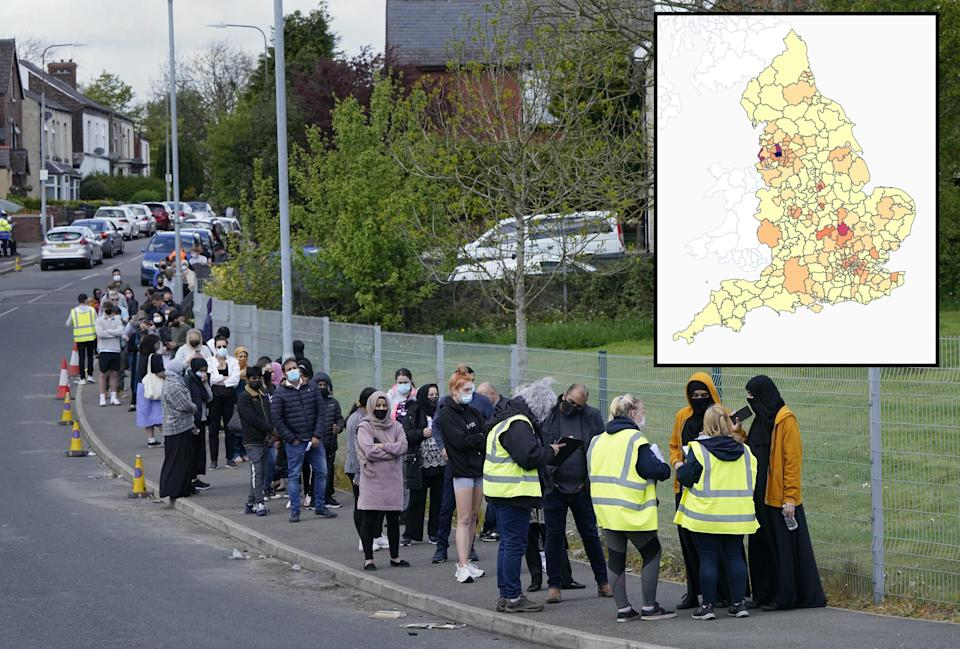 People queuing for COVID-19 vaccinations in Bolton on Tuesday amid the spread of the Indian variant in parts of England. (PA)