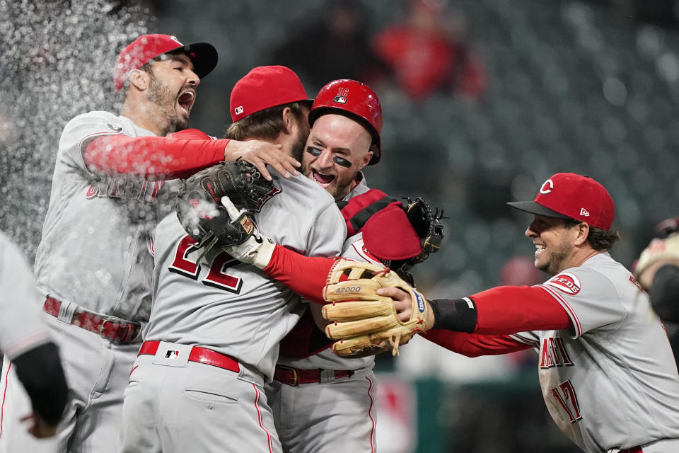 Cincinnati Reds teammates mob Wade Miley (22) after he pitched a no-hitter against the Cleveland Indians in a baseball game, Friday, May 7, 2021, in Cleveland. (AP Photo/Tony Dejak)