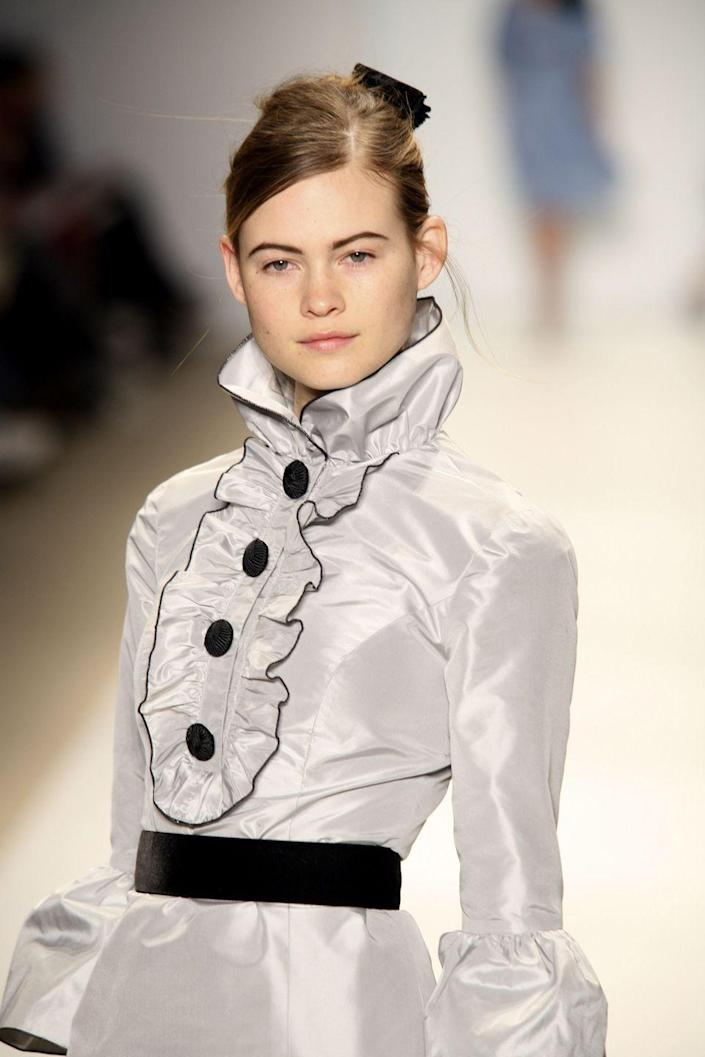 """<p>""""I was in Cape Town on vacation with my grandmother and grandfather. We went to the grocery store after church and this guy came up to me and asked if I was a model and wrote his number on a piece of paper and my grandfather was like this is so shady,"""" Prinsloo told <em><a href=""""http://fashionista.com/2009/04/life-with-behati-prinsloo"""" rel=""""nofollow noopener"""" target=""""_blank"""" data-ylk=""""slk:Fashionista"""" class=""""link rapid-noclick-resp"""">Fashionista</a> </em>in 2009. """"So we went home and told my parents about it and never did anything. And then the next time I was in Cape Town, Noelle [Doukas, daughter of Sarah Doukas, founder of Storm] came up to me and asked me to come into the agency. So I finally went in and signed with Sarah right there. I spent the summer in Cape Town and it went really well so they shipped me off to London.""""</p><p>Prinsloo first <a href=""""https://models.com/oftheminute/?p=917"""" rel=""""nofollow noopener"""" target=""""_blank"""" data-ylk=""""slk:debuted"""" class=""""link rapid-noclick-resp"""">debuted</a> as a Prada/Miu Miu Exclusive. She <a href=""""https://people.com/celebrity/who-is-behati-prinsloo/"""" rel=""""nofollow noopener"""" target=""""_blank"""" data-ylk=""""slk:became"""" class=""""link rapid-noclick-resp"""">became</a> a Victoria's Secret Angel in 2009 and later designed the Behati Loves Pink swimsuit capsule collection for the brand. She has appeared in campaigns for H&M, Nina Ricci, DKNY, and Nine West. </p>"""