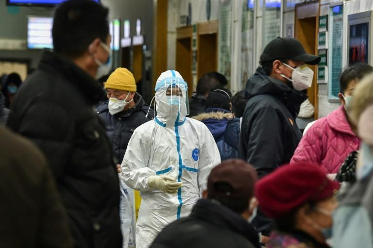 A medical staff member works in protective clothing in a hospital in Wuhan, the epicentre of the coronavirus that has so far killed 630 people and infected 31,000 in China (AFP Photo/Hector RETAMAL)