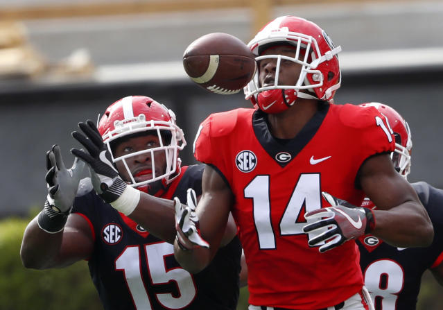 "Georgia wide receiver Trey Blount (14) and defensive back D""Andre Walker battle fro the ball during the first half of the G day intrasquad spring college football game Saturday, April 21, 2018, in Athens, Ga. (AP Photo/John Bazemore)"