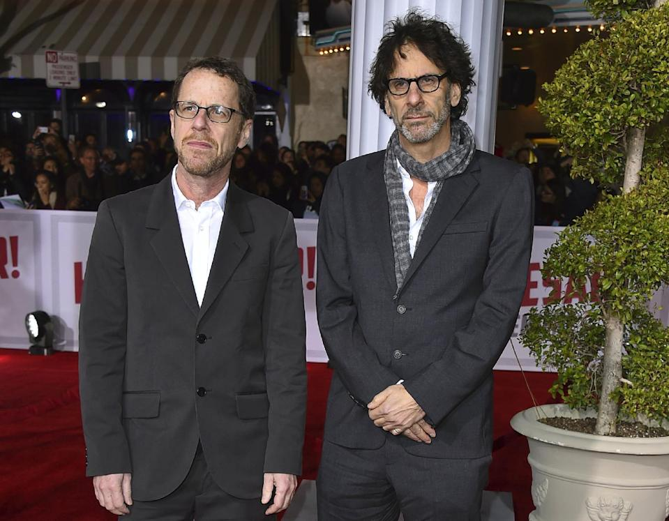 """FILE – This Feb. 1, 2016 file photo shows brothers Ethan Coen, left, and Joel Coen at the world premiere of """"Hail, Caesar!"""" in Los Angeles. (Photo by Jordan Strauss/Invision/AP, File)"""