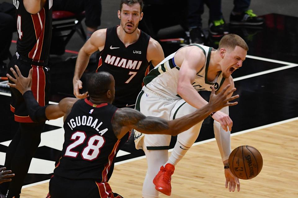 Bucks guard Donte DiVincenzo (0) gets fouled by Heat guard Goran Dragic (7) in the first half during game three in the first round of the 2021 NBA Playoffs.