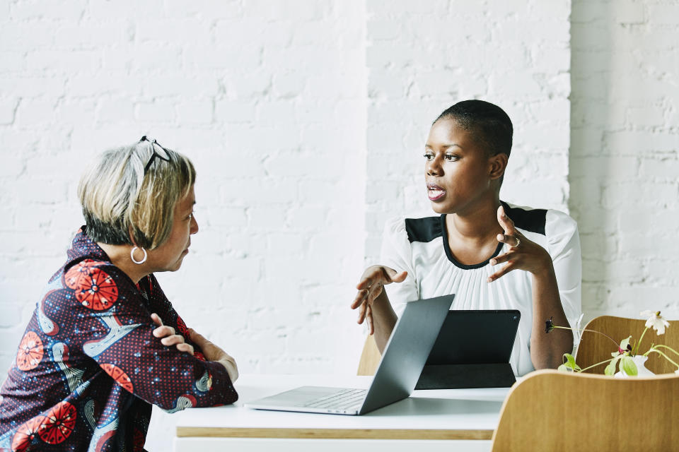 Female financial advisor in discussion with client in office conference room