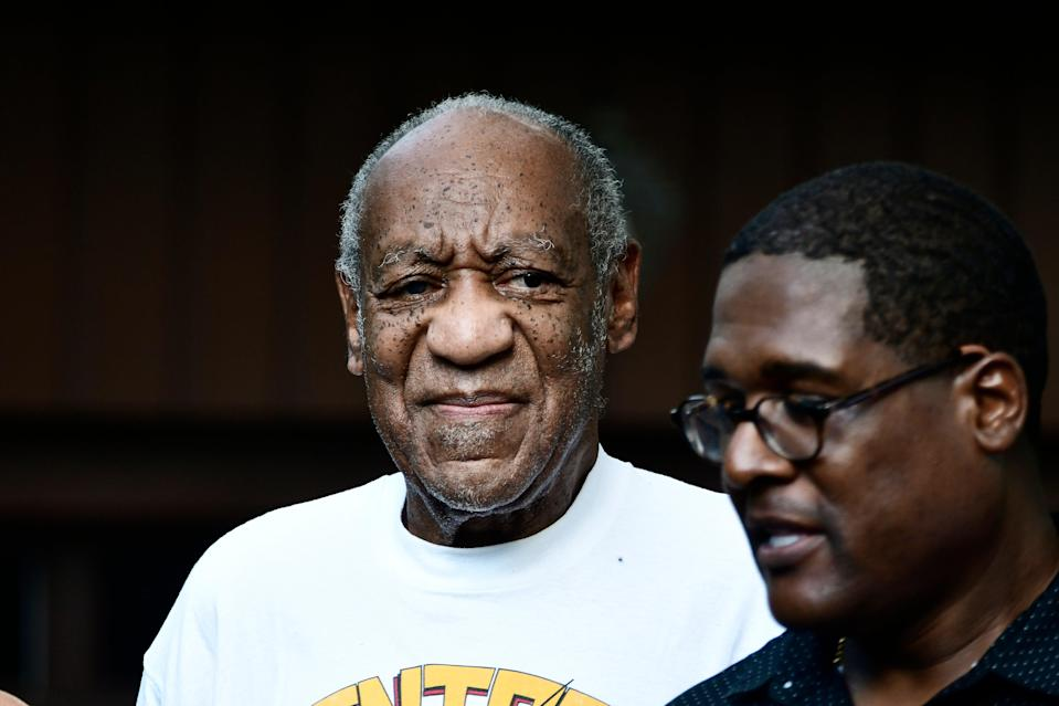 Bill Cosby, freed from jail, and his spokesman  (EPA)